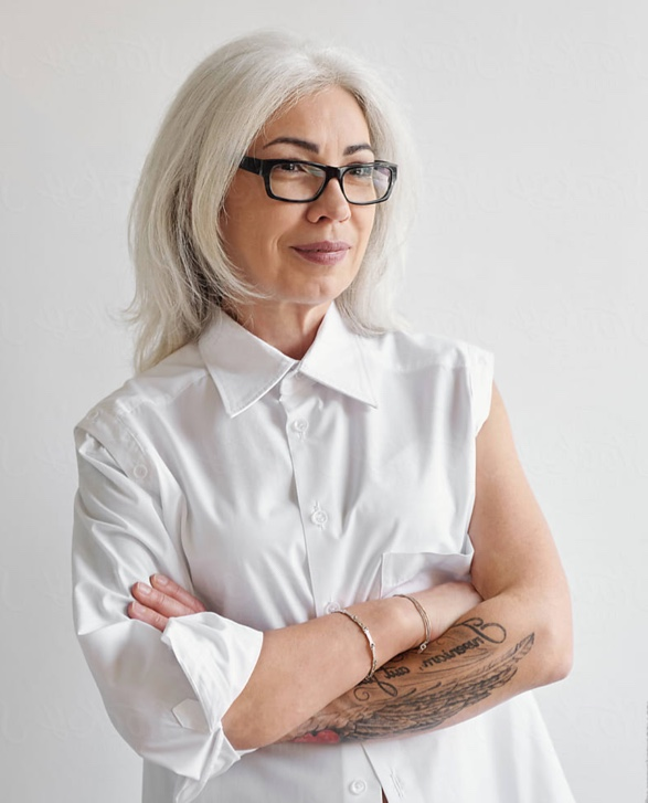woman-with-forearm-tattoo-wearing-glasses